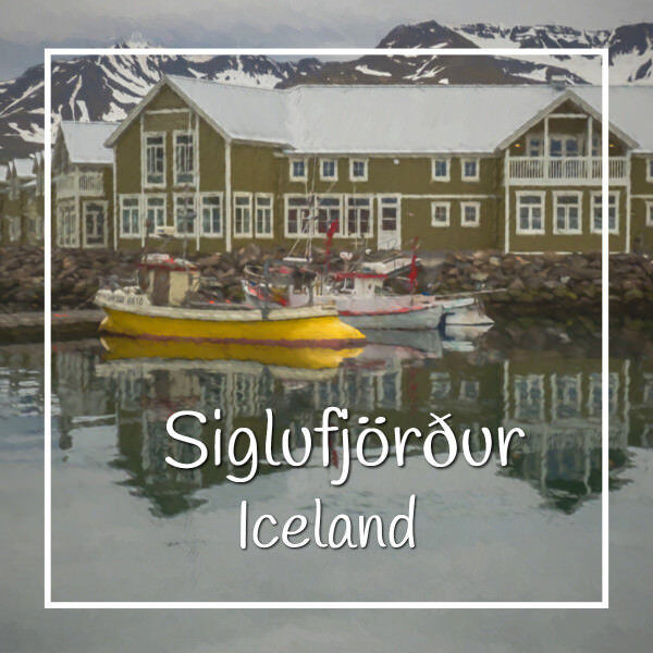 """lodge along water with boats and text """"Sigulfjordor Iceland"""""""
