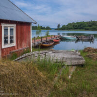 What could be more picturesque than a brightly painted boathouse and a collection of classic wooden boats? - ExplorationVacation #Finland #visitåland #discoverfinland #summervacation #alandislands