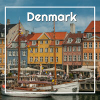 "Small ships crowd a colorful old harbor with text ""Denmark"""
