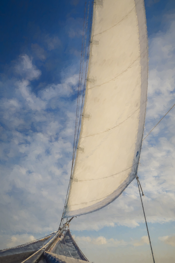 photo painting of a sail against a blue sky