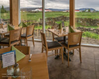 dining tables with a view of green fields