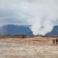 view of steaming vent with people watching