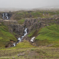 waterfalls in green hillsides