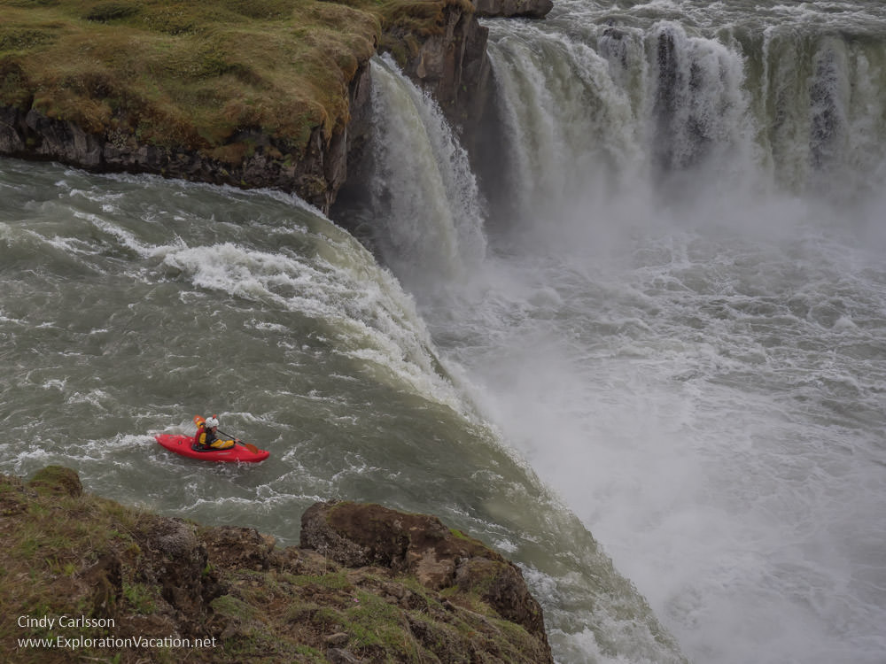 Man in a kayak just before going over a waterfall