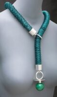 green spring with silver forming a casual necklace