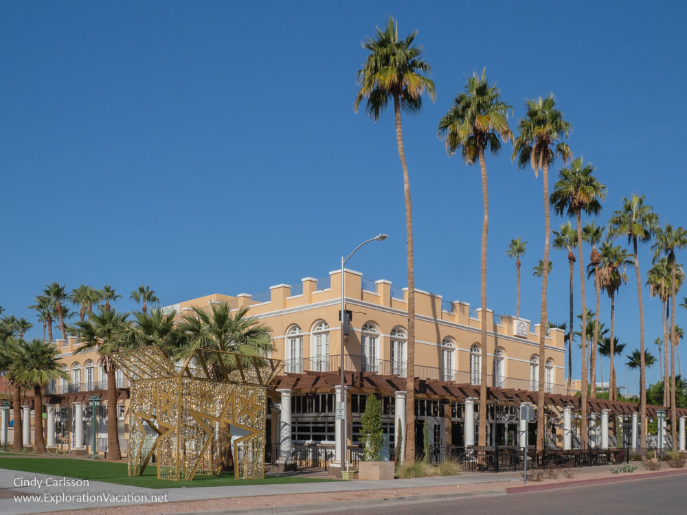 historic hotel with palm trees and Christmas decorations