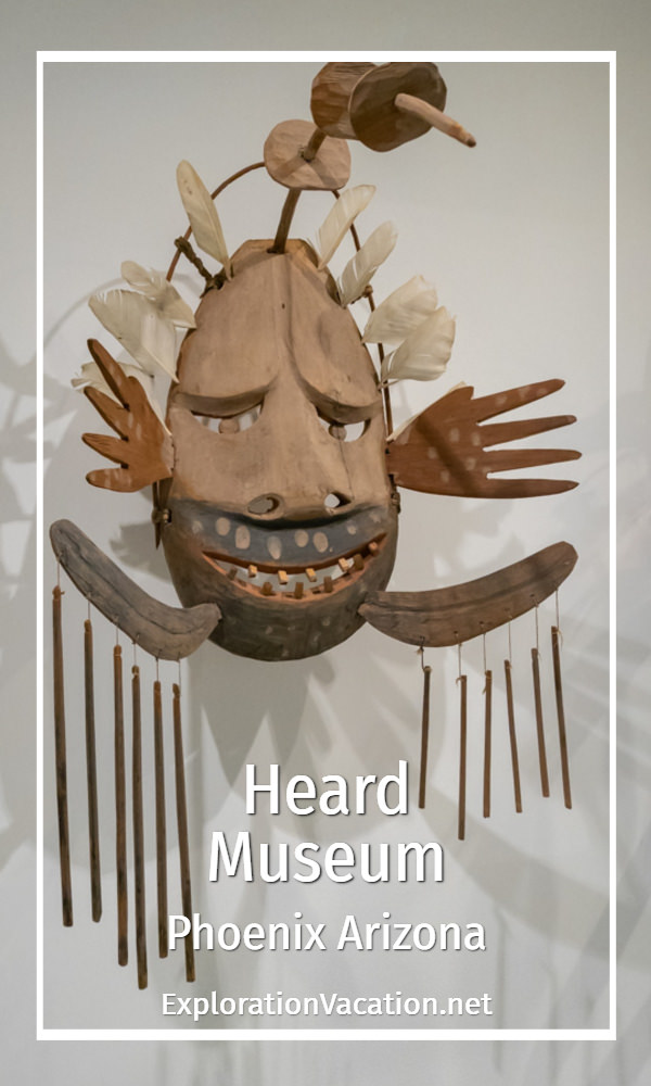elaborate carved mask with text