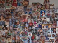 Bulletin board covered with pictures of families and children