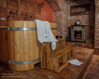 wooden tub, bathrobe, slippers, and beer glasses in a brick cellar