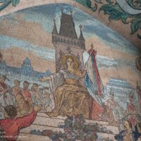 mosaic of Prague city hall tower and heroic figures