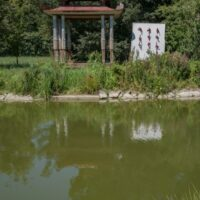 Asian pavilion reflected in a pond
