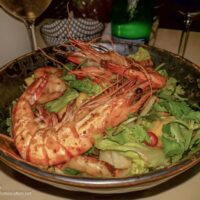 bowl with salad greens and giant crawfish