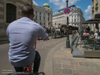 pedicab driver's back and street scene in Vienna