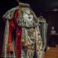 red robe with fur trim and gold accessories