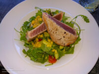 Seared tuna on a bed of greens