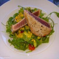 Seared tuna on a bed of greens