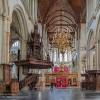 wooden pulpit and towering spaces inside the church