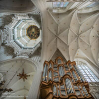 view up into the domes and arches of the white ceiling
