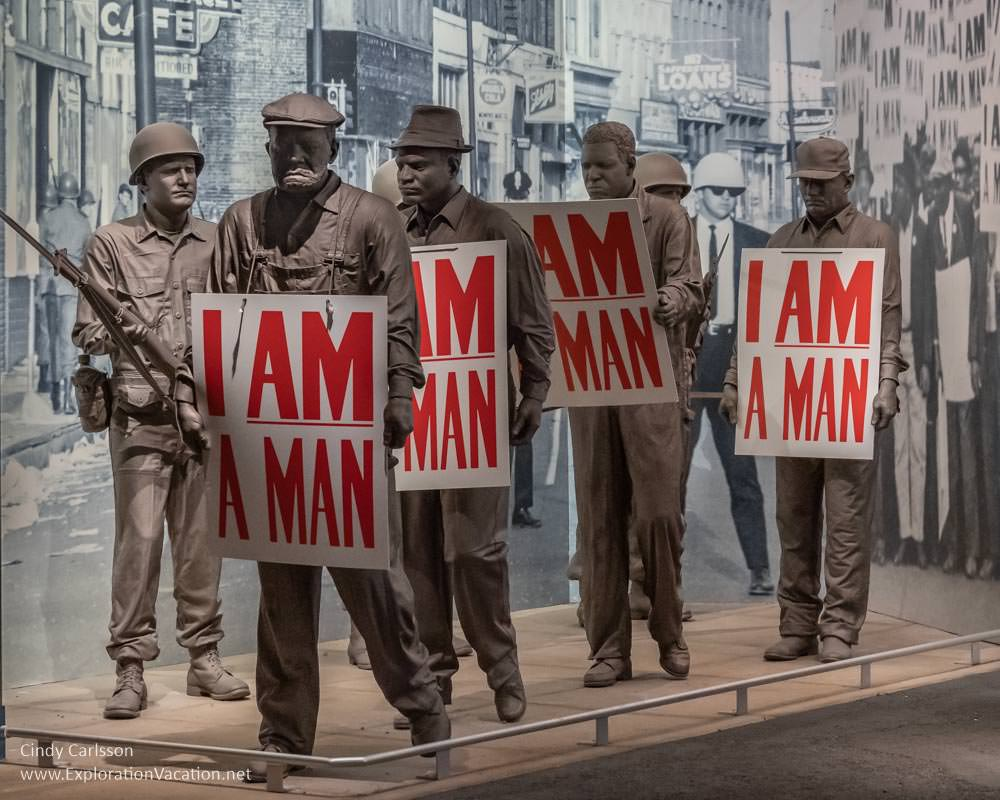 "statues of African American men holding signs that say ""I am a Man"""