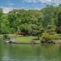 expansive Japanese garden along a lake