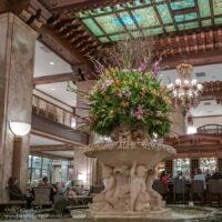 carved fountain with huge flower bouquet in a large open lobby