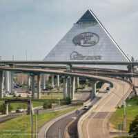 large glass pyramid towering above freeway entrance