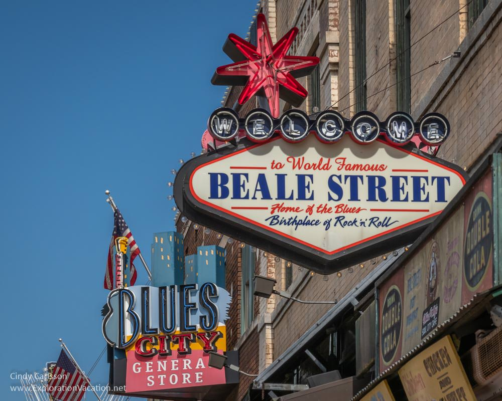 colorful neon signs on Beale Street during the day