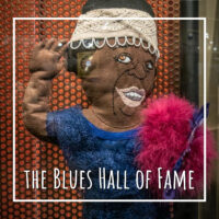 "felt doll of singer Ma Rainey with text ""The Blues Hall of Fame"""