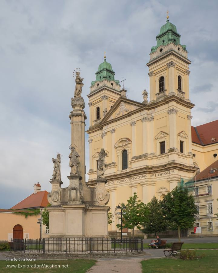fountain and church with two towers