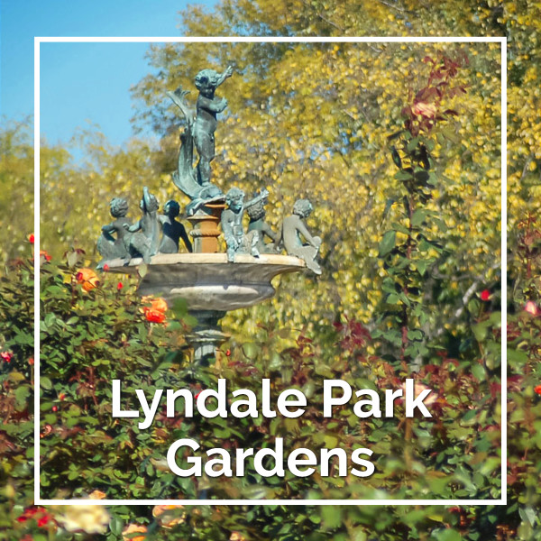 "Top of the fountain above roses with text ""Lyndale Park Gardens"""