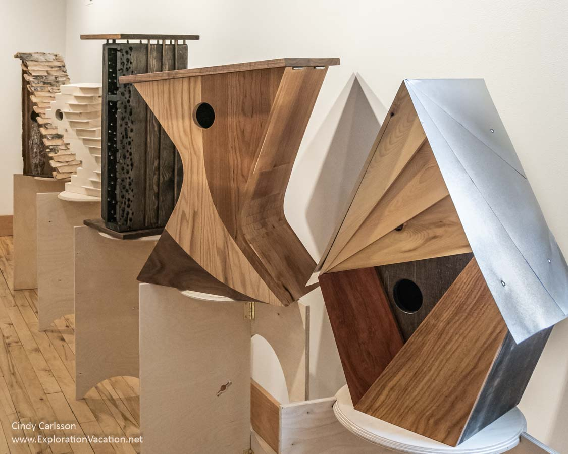 selection of artful wooden birdhouses