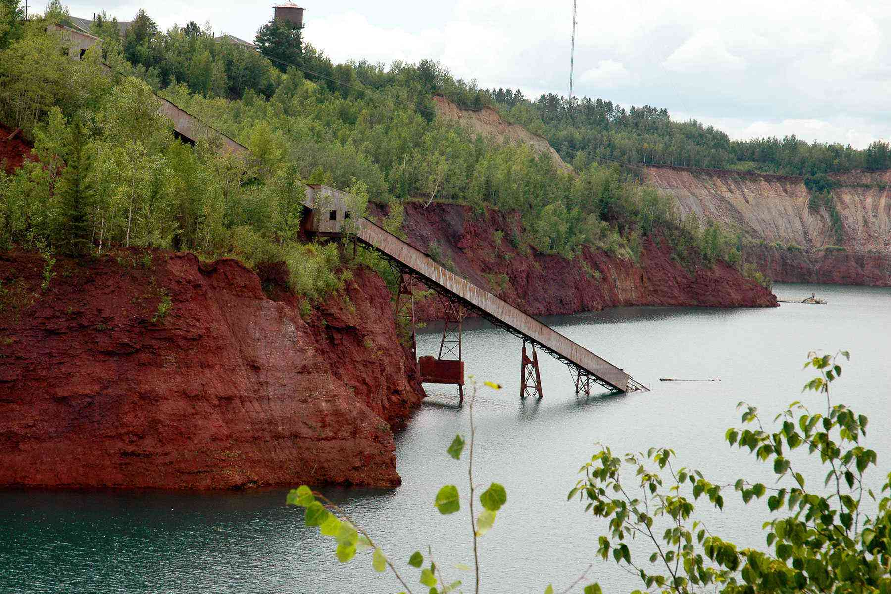 view of mine pit with water and conveyor system
