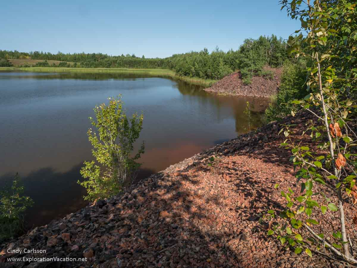 iron ore tailings piles above a lake