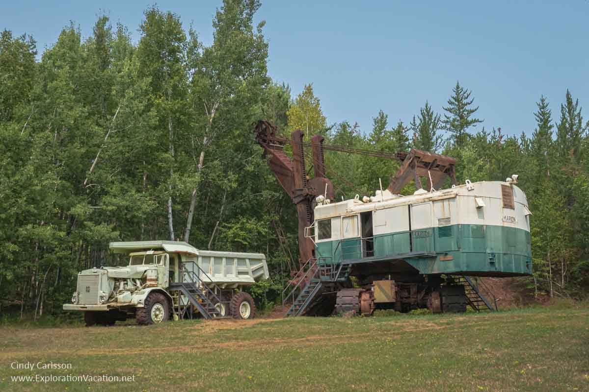 large white dump truck with a very large electric shovel