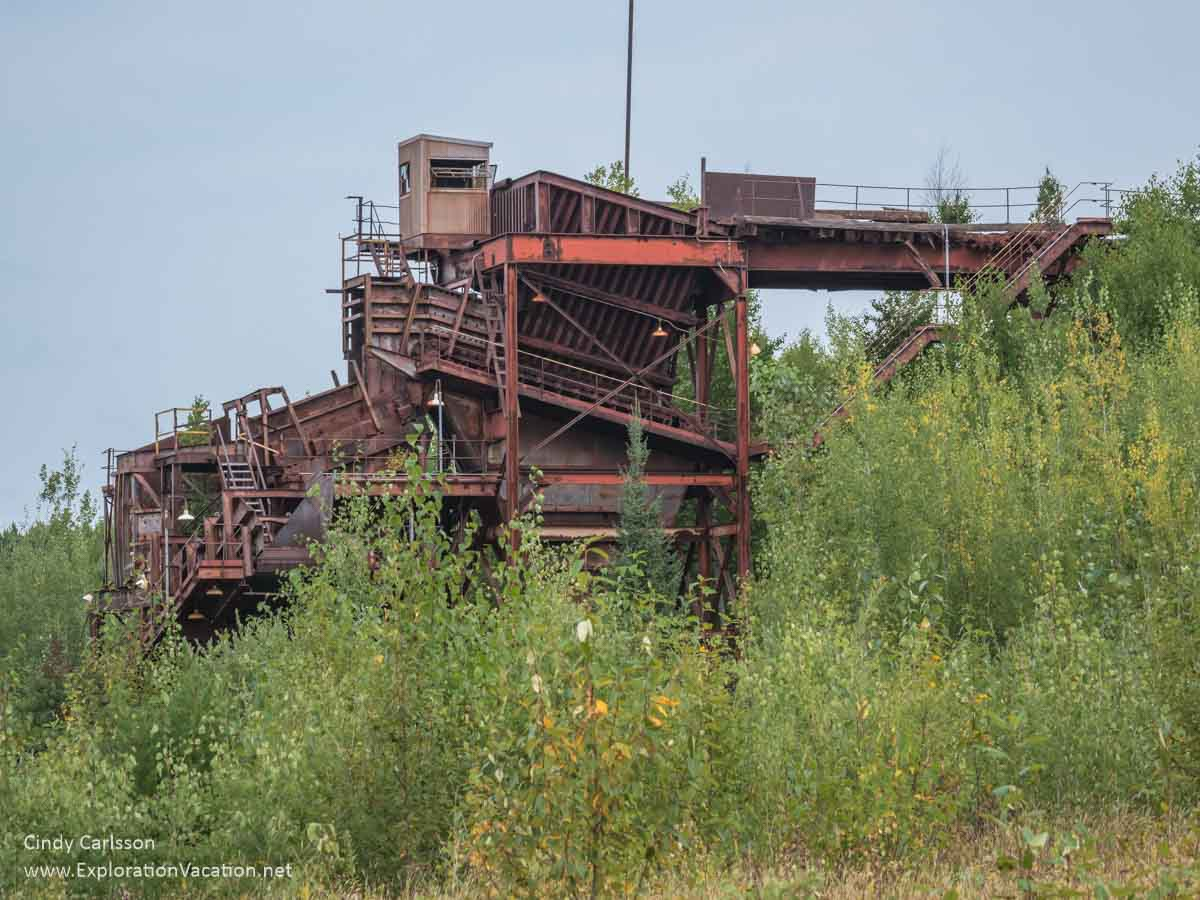 rusty structure used to transfer ore from trucks to a conveyor