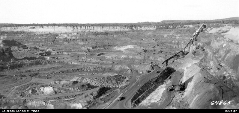 vintage black and white photograph of an open pit iron mine