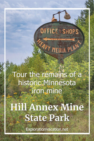 """rusty sign with text """"tour the remains of a historic Minnesota iron mine - Hill Annex Mine State Park"""""""