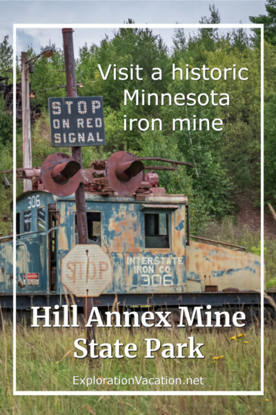 """rust old electric locomotive with text """"Hill Annex Mine State Park"""""""