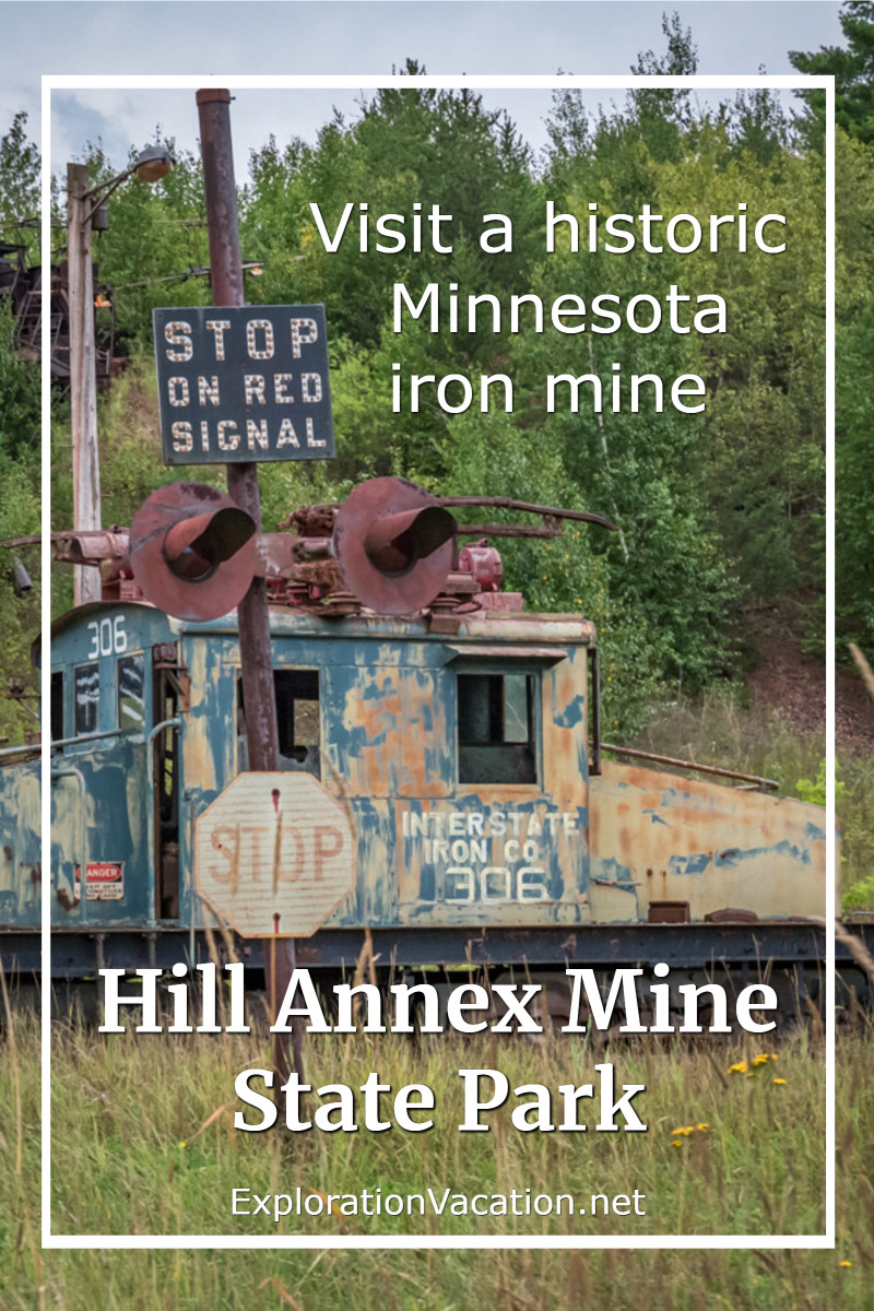"rust old electric locomotive with text ""Hill Annex Mine State Park"""