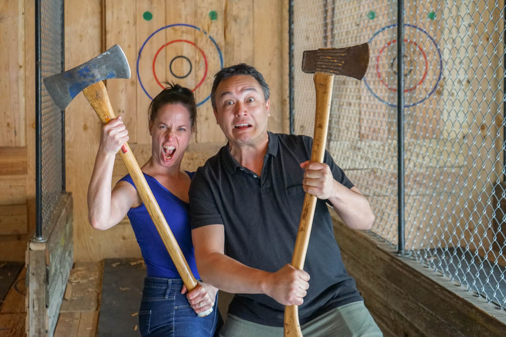 two people looking intense holding axes