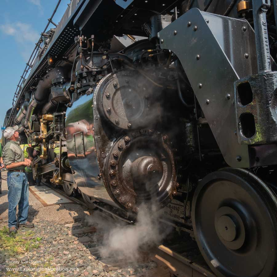 man standing close to a locomotive