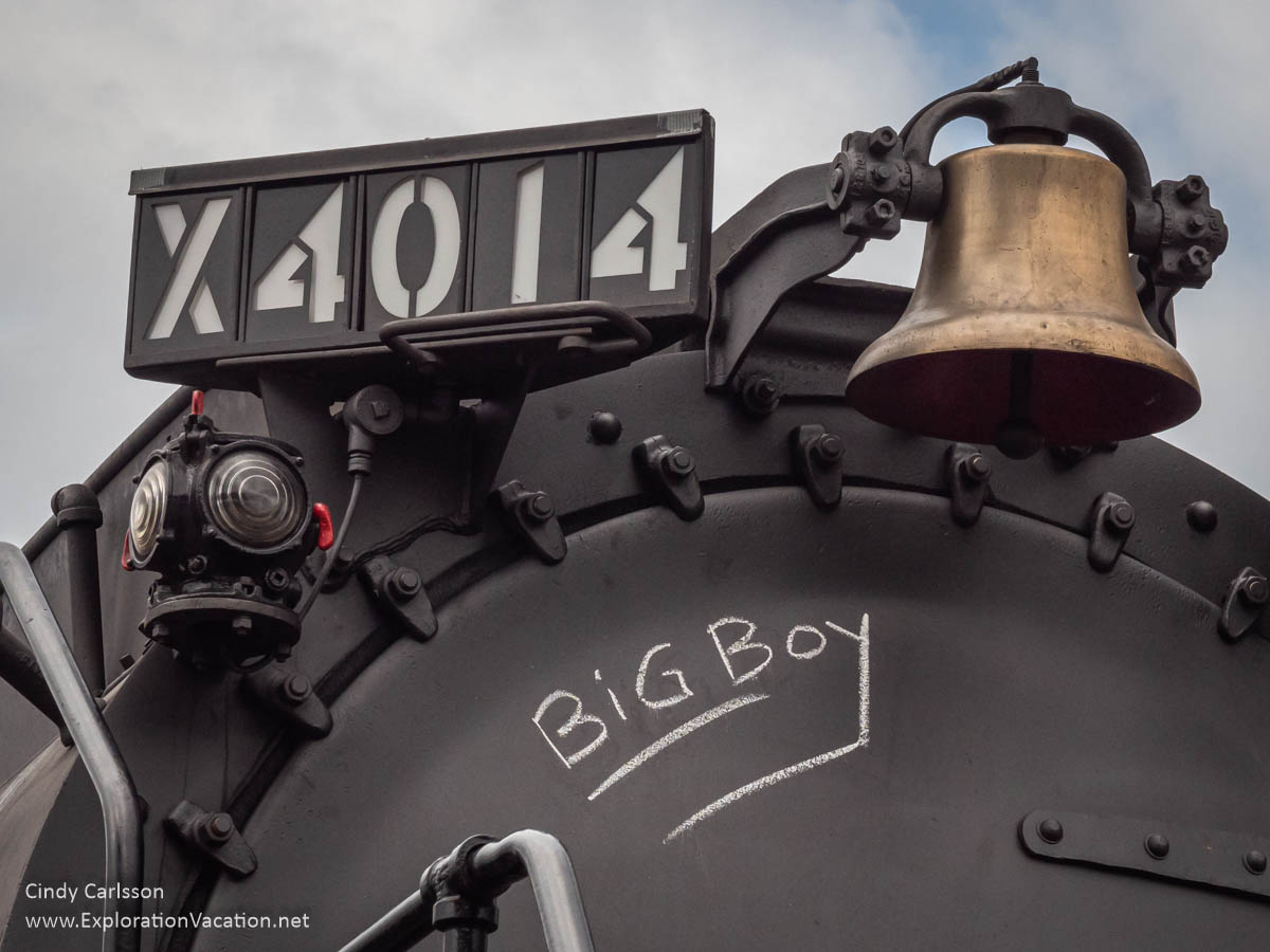 "close up of front of locomotive with bell and ""Big Boy"" handwritten to look like chalk"