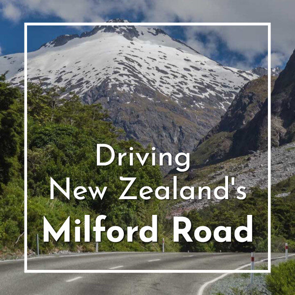 """mountains rising above a road with text """"Driving New Zealand's Milford Road"""""""