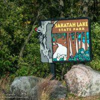 Sakatah Lake State Park sign and trees