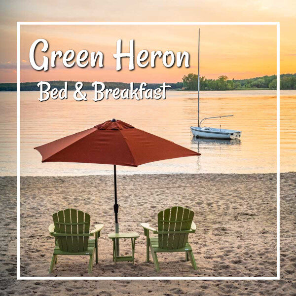 """sunset on a beach with chairs and umbrella and text """"Green Heron B&B"""""""