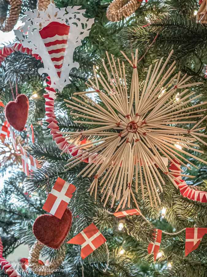 straw and paper Christmas decorations on a tree