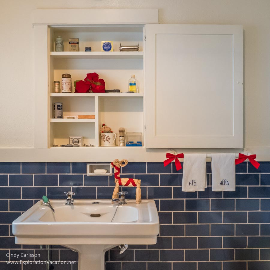 blue and white bathroom with Christmas decorations