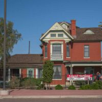 red brick Queen Anne style Victorian house