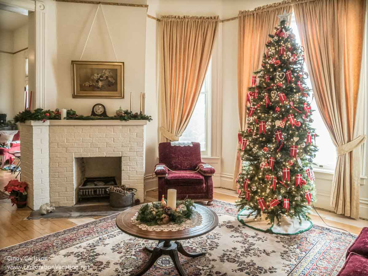living room or parlor with fireplace and Christmas tree with Danish decorations