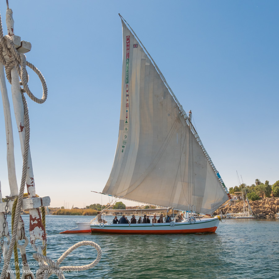 Felucca with sail up taking passengers on a tour